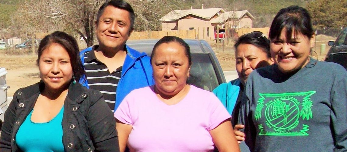 [ID: Five New Mexico Caregivers Coalition pose for a picture outdoors]