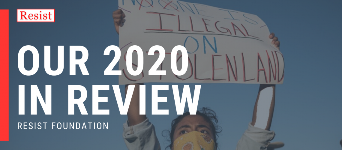 [Image description: Cover of Resist's 2020 Year in Review. The foreground image is of a person wearing a yellow mask stands with arms up holding a sign that reads: