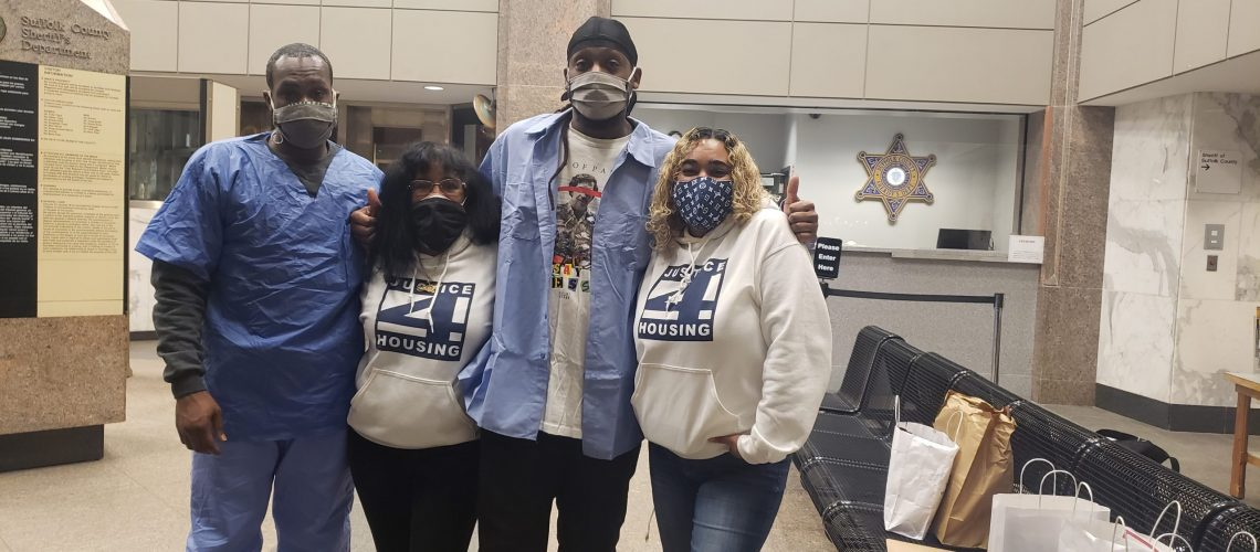 [Image description: Members of Justice For Housing pose for a picture wearing masks.]