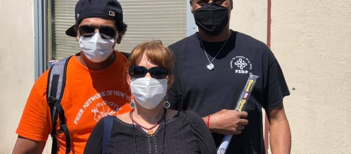[Image description: Three members of Peer Network of New York pose with masks.]