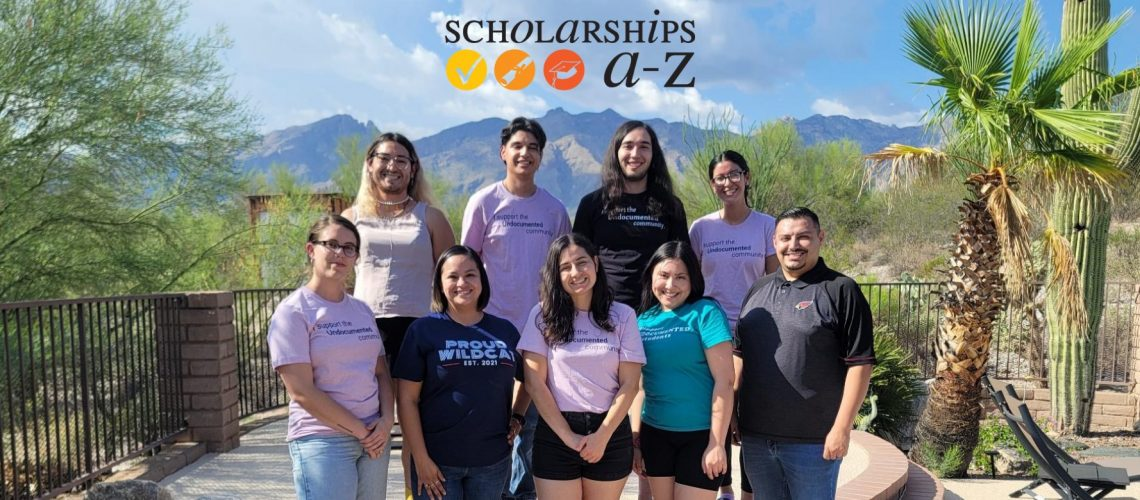 [ID: Members of ScholarshipsA-Z pose for a picture. There is a mountain in the foreground. Their logo sits above their heads]