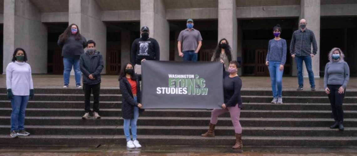[ID: Members of Washington Ethnic Studies hold a sign that reads: